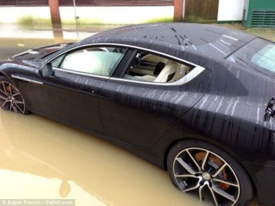 Driver Forced to Abandon New £150,000 Aston Martin in Floodwater