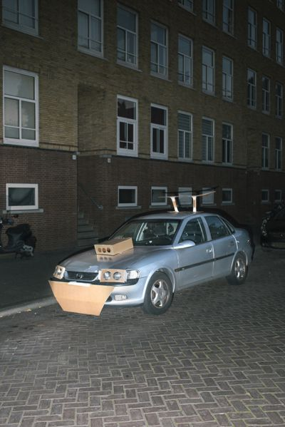 man pimps cars with cardboard
